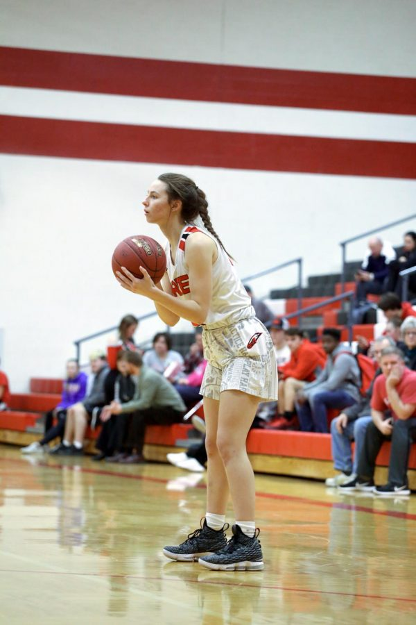 Junior Halie Jones goes to pass the ball Tuesday against Campus. Eagles won 58-21 against Campus.