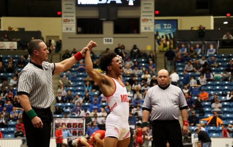 Senior Devin Onwugbufor yells in victory after gaining his first state title. Onwugbufor has wrestled for most of his life.