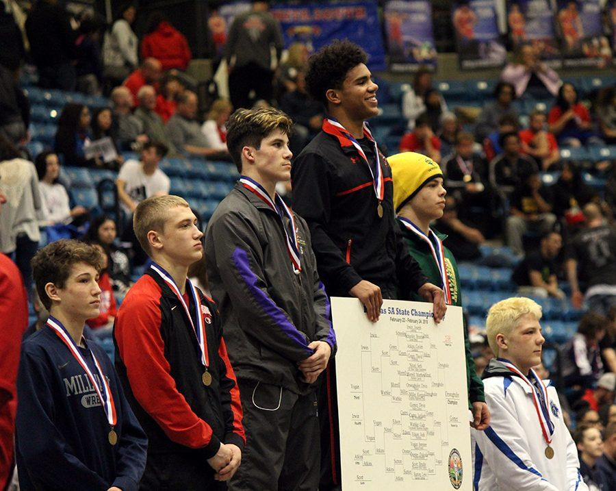 Senior Devin Onwugbufor stands on the first place 5A state championship podium. Onwugbufor has overcome many obstacles to get to where he is today.