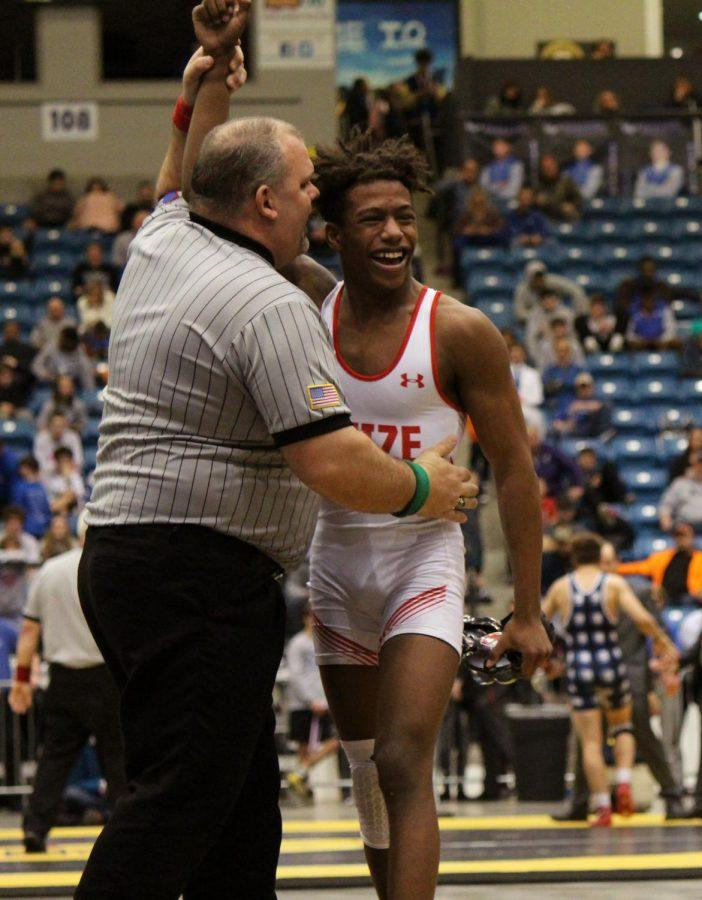 Sophomore+Duwayne+Villalpando+smiles+after+winning+his+first+state+title.+Villalpando+wrestled+a+senior+from+Mill+Valley+in+the+state+wrestling+finals+on+Saturday.+