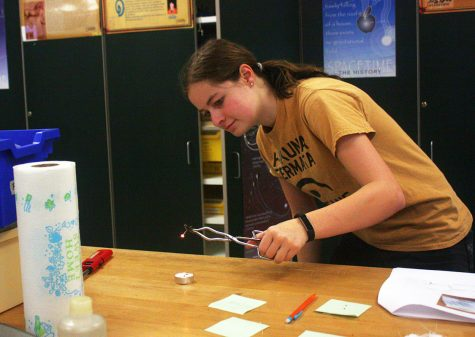 Sydney Epke, 9, practices for Science Olympiad. This is Epkes first year on the team. Photo by K. Fisher