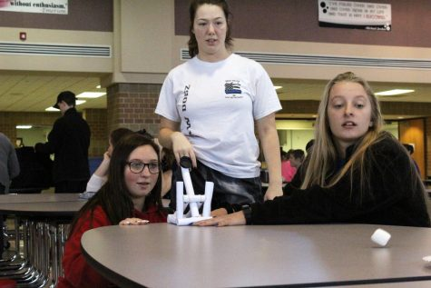 Students participate in the catapult contest Tuesday for Bard