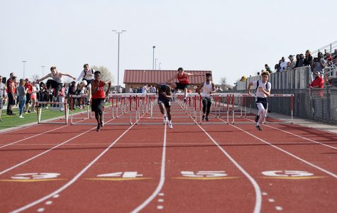 Freshman Jacob Hanna and junior Caden Raile race in the 100 M hurdles. Maize won the Maize Invitational on Thursday.