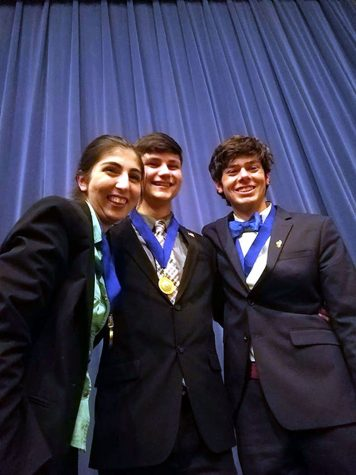 Forensics nationalist, Kimiya Monfared, Ethan Cox,  and Sam Harder posing for a picture. This event took place at Wichita East High School. Photo courtesy of W. Rice
