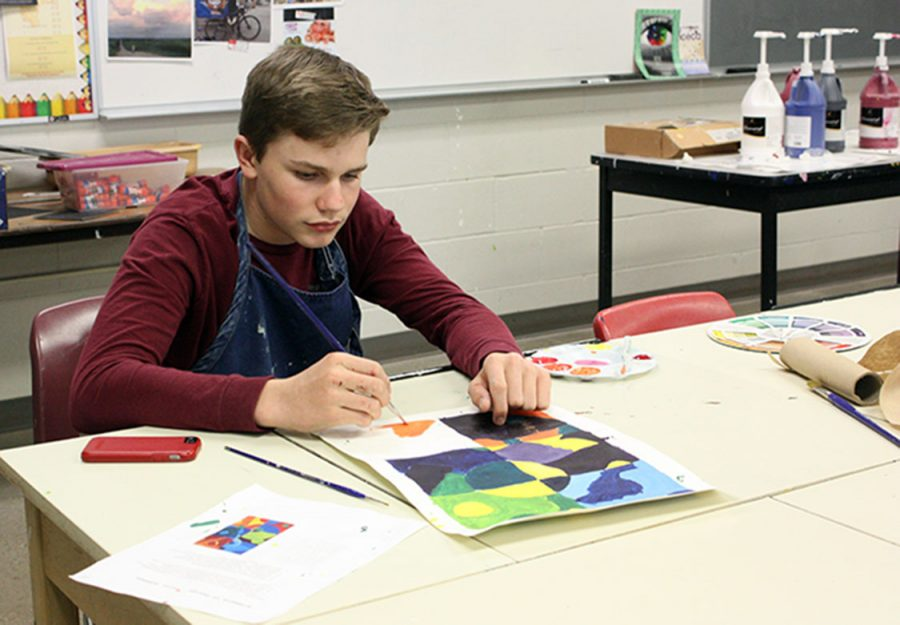 Jakeb Wilson paints a picture in Gegen's class. The class this was in was Art I. Photo by K. Fischer