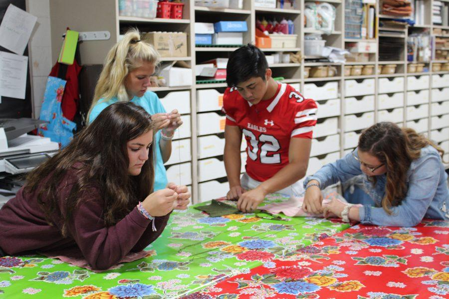 Students in Beth Janssen's art class are working on quilt inspired artist Marie Watt. The final product eventually will be on display at Crystal Bridges Museum in Arkansas.