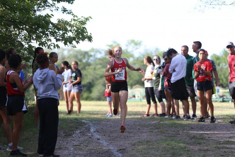 Zoie Ecord runs in the 5k race, placing 3rd.
