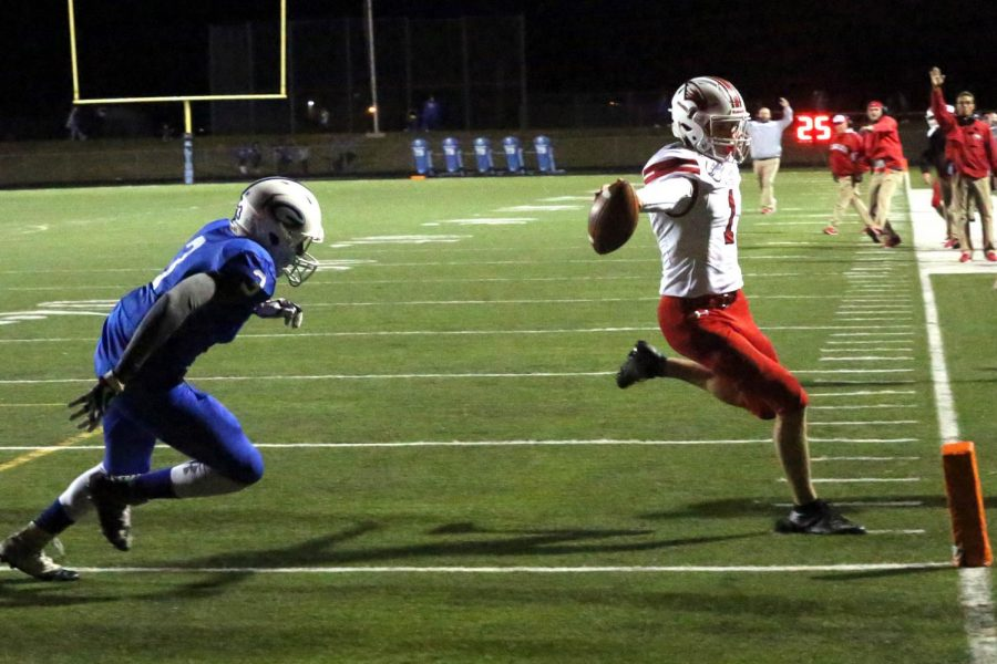 Caleb Grill scores one of his two touchdown runs in Friday's 27-2 victory over Goddard. Grill also had a passing TD.