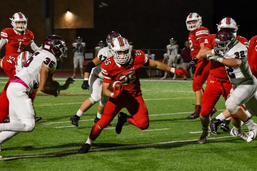 Junior Caden Cox cuts back to avoid the Salina Central defence. The Eagles defeated Salina Central 48-26.