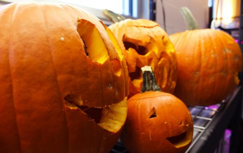 Students carve pumpkins in class