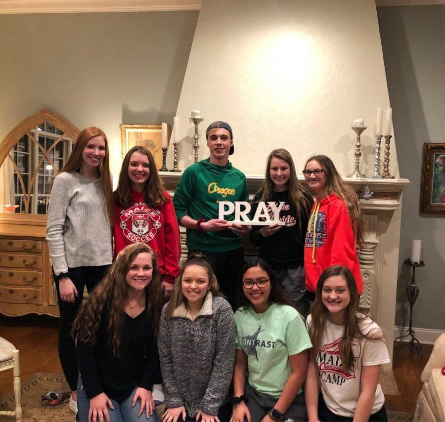 Logan Forrest with friends at bible study.