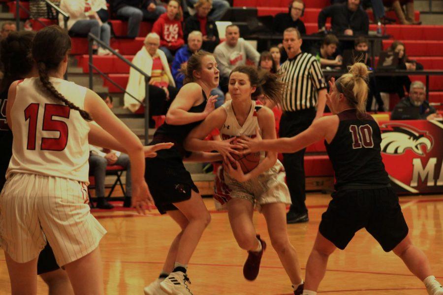 Hailee Jones pushes through Buhler players.
