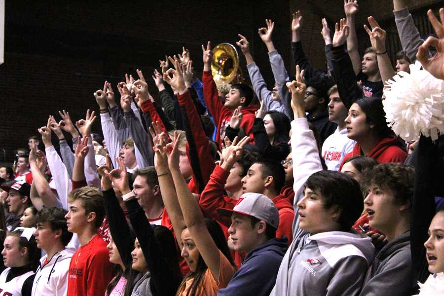 The+student+section+cheers+after+a+three-pointer.+