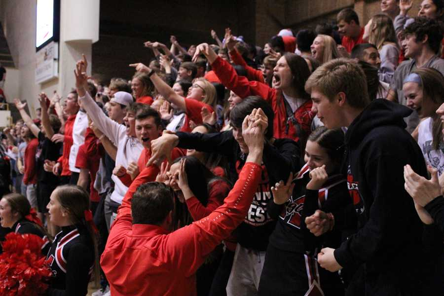 The+student+section+and+Dr.+Botts+cheer+after+Cade+McGaugh+makes+a+shot.