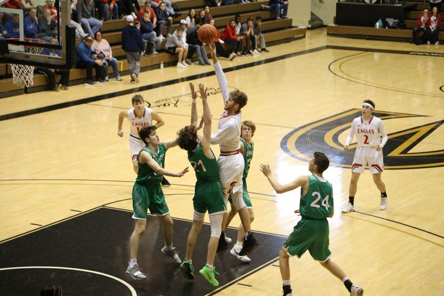 Senior Devon Koehn jumps up for a shot through Carrol defenders. Koehn scored 17 points total.
