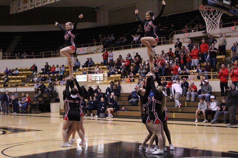 Cheerleaders cheer between quarters.