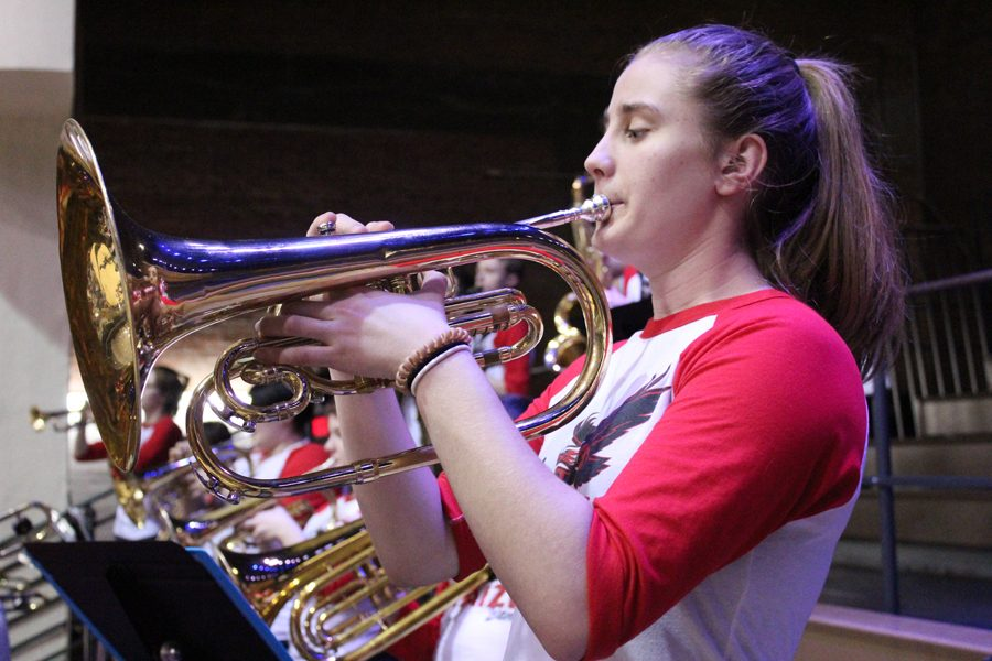 Trumpet instrumentalist plays music in between quarters.