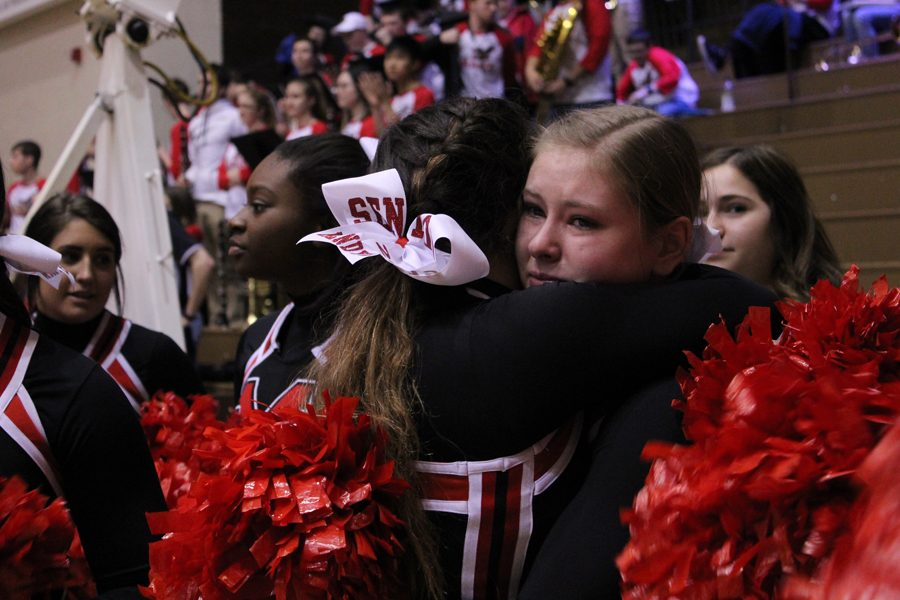Maize High cheerleaders are emotional after the completion of the game. This is the last game for the senior cheerleaders.