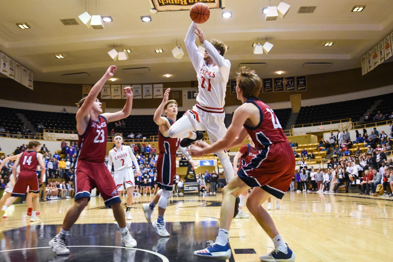 Devon+Koehn+dunks+in+the+third+quarter.+