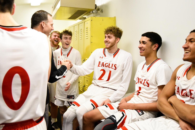 Coach+Chris+Grill+congratulates+senior+Devon+Koehn+on+Thursday%27s+game.+