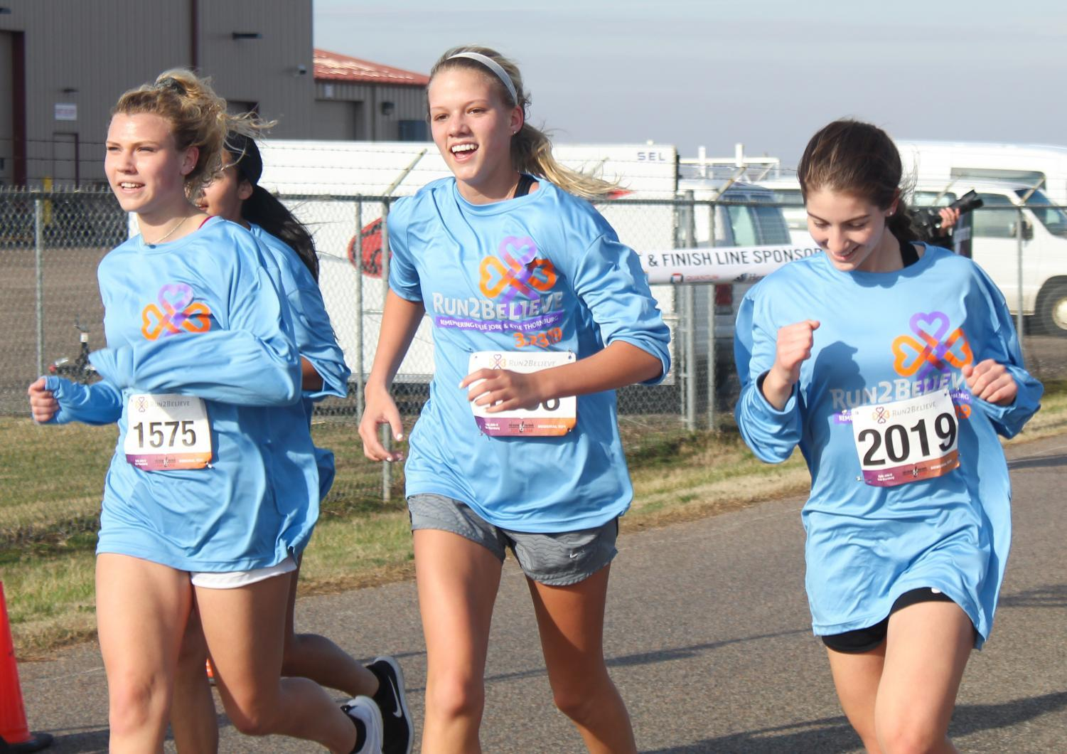 Families+and+students+participating+in+the+annual+Run2Believe+event.+The+event+raises+awareness+for+drinking+and+driving.+