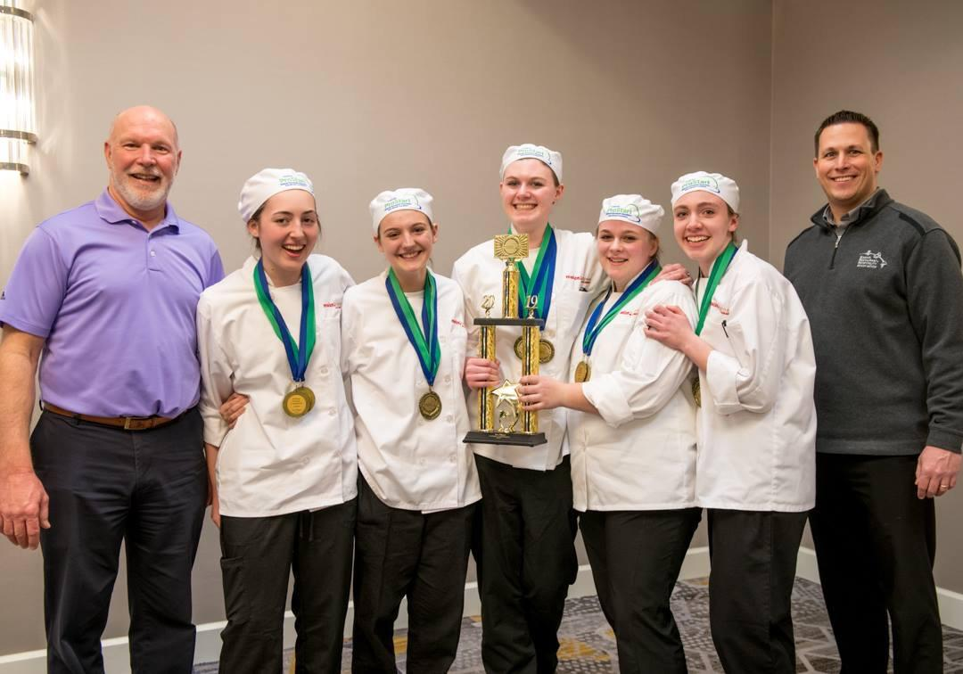 The Maize Career Academy team pose for a picture with their first place trophy. They will now train to compete in Nationals in May.
