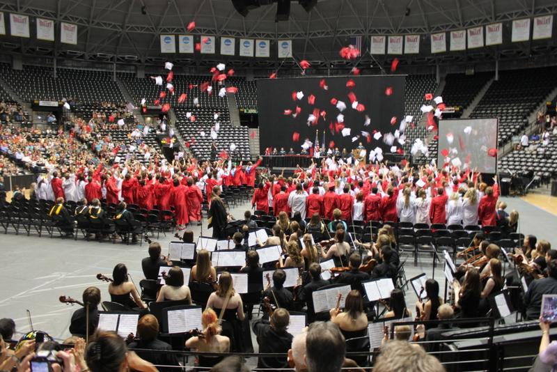 Students throwing their caps at a previous graduation.  No graduating class at Maize has had the laude system yet.