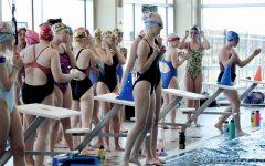 Swim continues practice with broken pool heater and algae contamination
