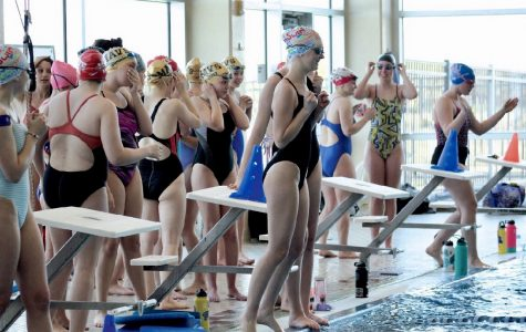 Swim continues practice with broken pool heater and algae contamination