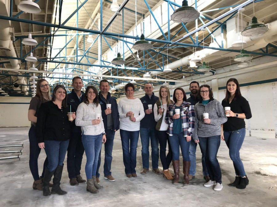 Employees from Cocoa Dolce and Birds Eye Holdings at the future headquarters and production facility. Calli Hebert, Casey Voegeli, Ben Voegeli, Mona Logsdon, Chad Hanson, Ashley Moore, Collin Stieben, Kristin Khosravipour, Angie Gonzalez, Amber Travis, Kylie O'Connor, Lisa Mickey.