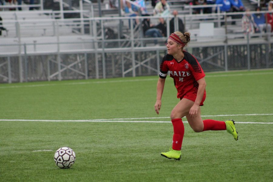 Senior Payton Eskridge takes ball against Hutch. Eskridge scored two goals.