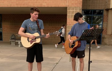 Senior, Mitch Adamson, and Junior, Tate Johnson, playing worship music outside of school. Adamson and Johnson have played outside of the school building in the morning.