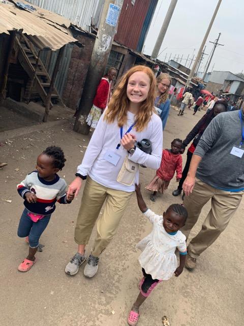Zoie+Ecord+walking+with+children+in+Kenya.