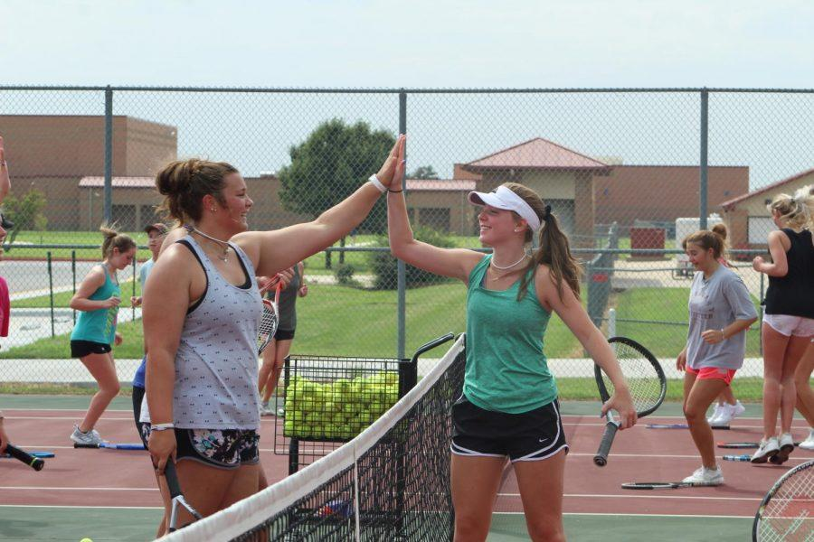 Jolei Hertzel and Riley Wertz celebrating after winning a game in practice.