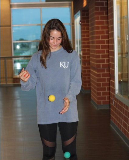 Lanie Wolf, sophomore, juggles two small balls in a Bal-A-Vis-X exercise that improves hand to eye coordination.