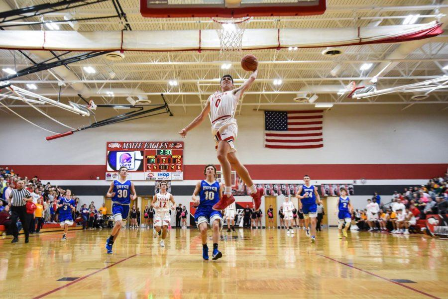 This photo was taken during the men's 2018-2019 basketball season and features graduate Caleb Grill dunking. Bartlett entered this photo for a national journalism contest.