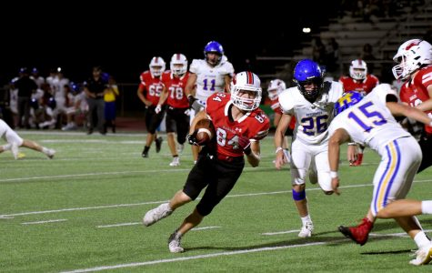 Clayton Crockett runs the ball. Football defeated Hutchinson 55-14.