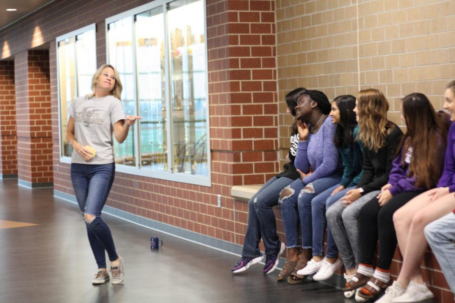 Jennifer Kerr, French Club sponsor, shares a funny moment with her French II class in the commons area.