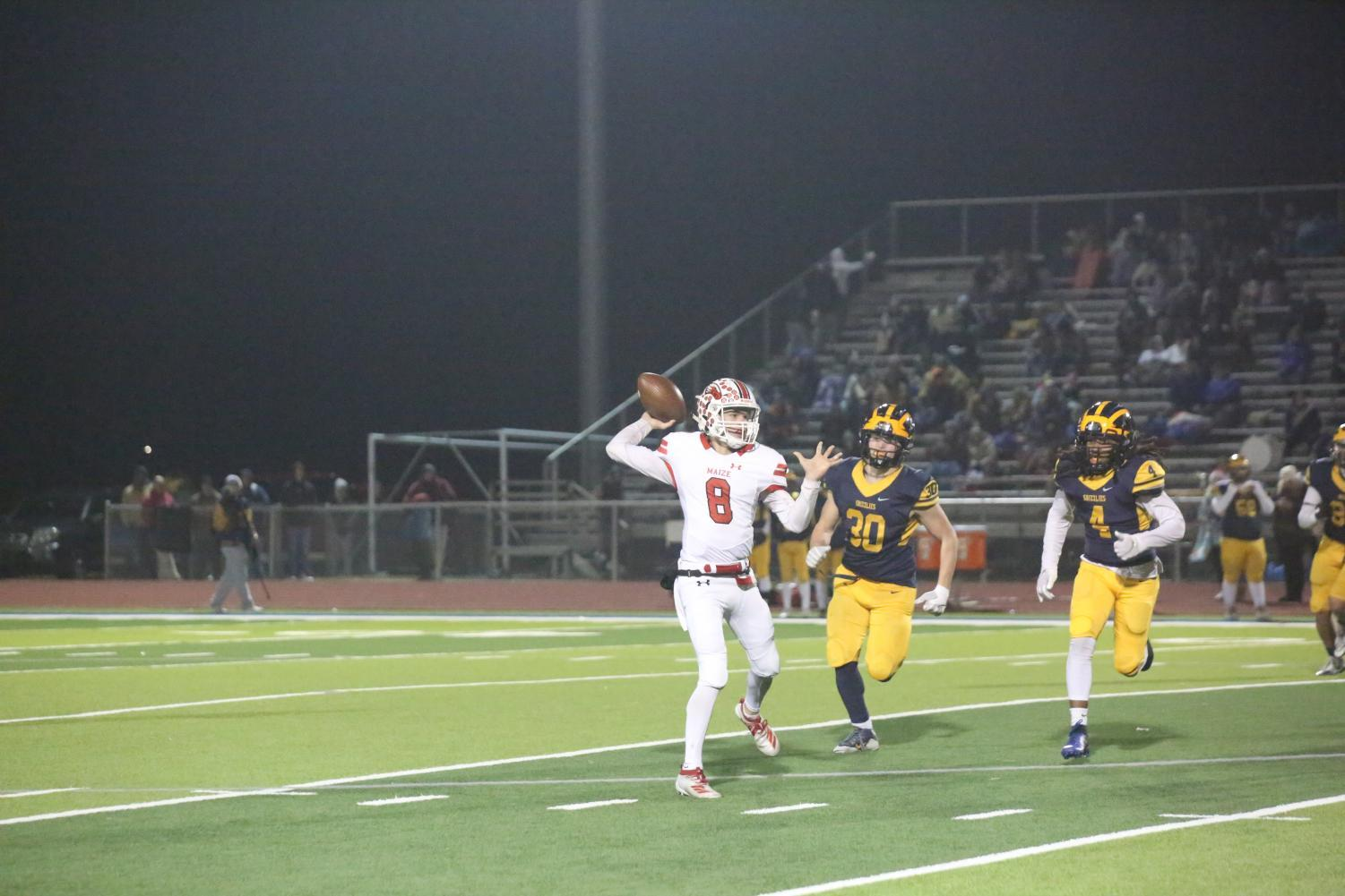 Senior Camden Jurgensen throws a pass to a receiver. Jurgensen scored three touchdowns during the game.