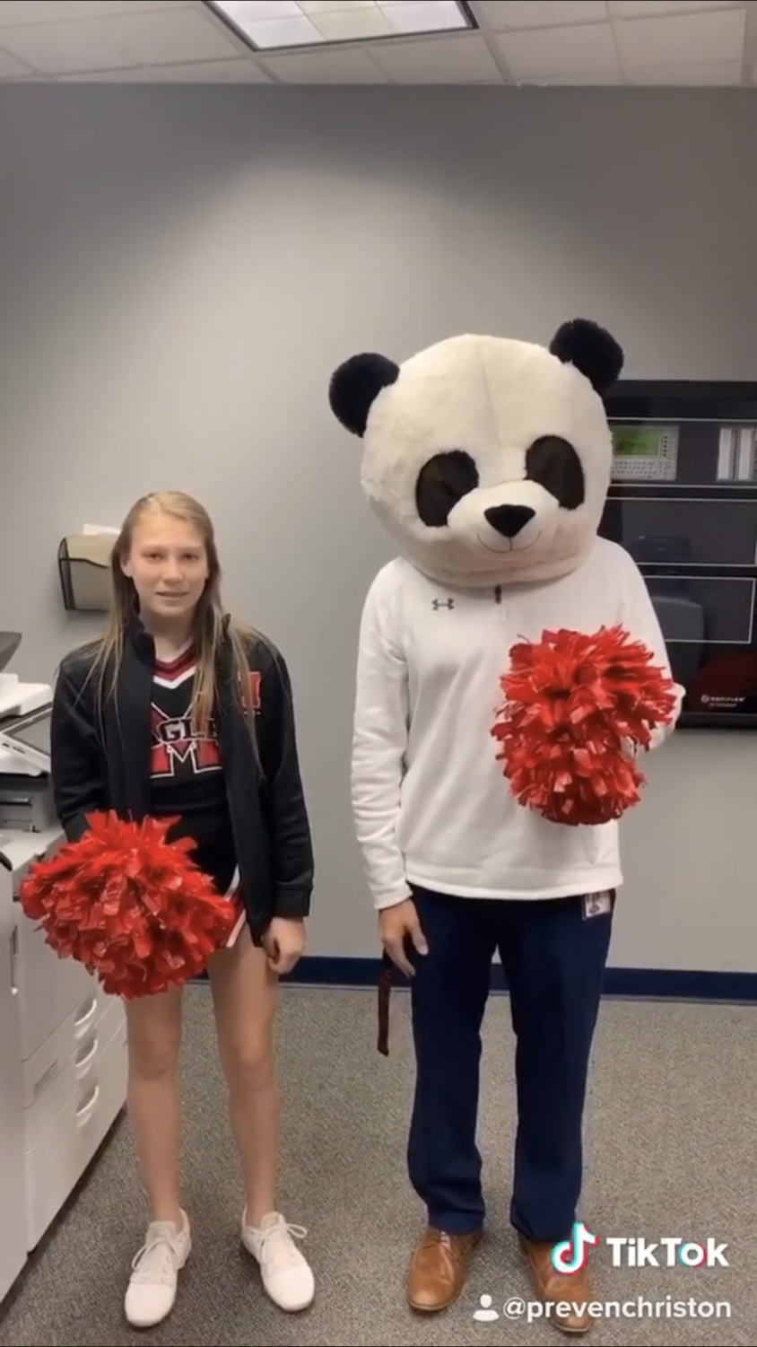 Maize high principal participates in making a Tik Tok to engage with students.