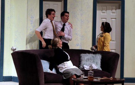 Senior Lyza Heeb plays as one of Bernard's fiances. Bernardo and Robert stop the fiance from entering a room as the maid [Henderson]  watches.