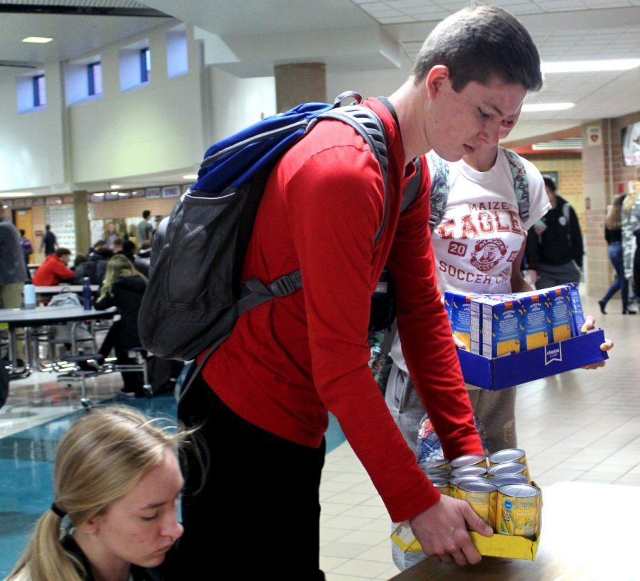 Students+brought+in+canned+food+donations+this+week+to+%22stuff+the+turkeys%22+for+the+less+fortunate.+This+food+drive+took+the+place+of+Maize%27s+annual+%22Deck+the+Halls%22+drive.