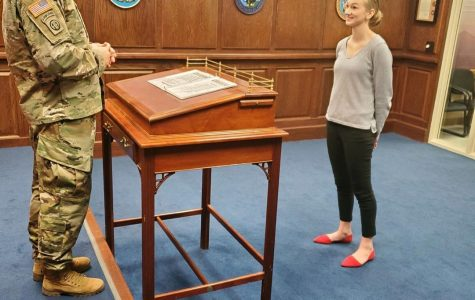 Senior Madelyn Mies swearing into the United States of America Navy at MEPS in Kansas City. Mies was inspired by all of her friends and family surrounding her to pursue joining the Navy.