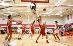 Junior Jacob Hanna dunks at Maize's first home game. Hanna had three slam dunks in the game's first half.