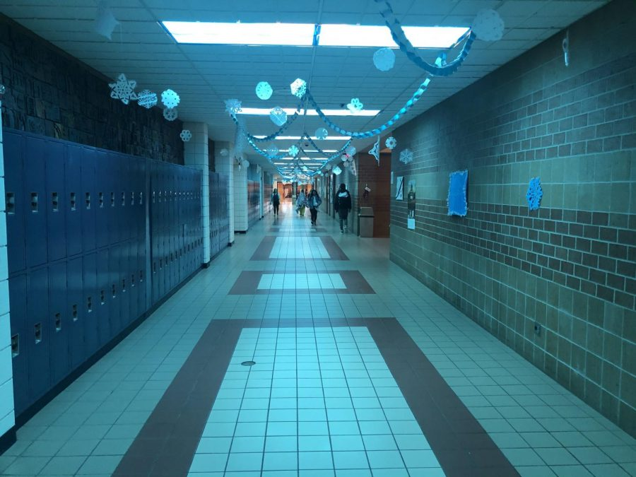 The Maize High Hallway is decorated with snowflakes for Safe Week.