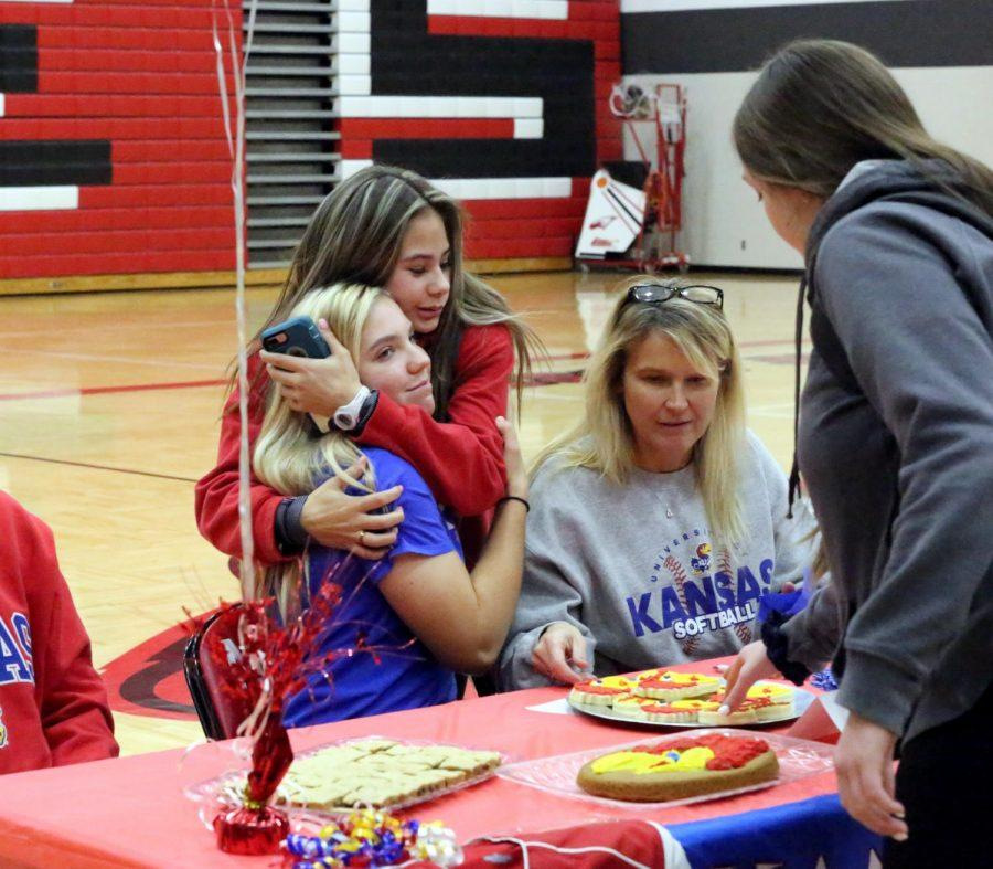 Senior Sophia Buzard and junior Bellamy Hendricks hug after Buzard's signing on Wednesday.