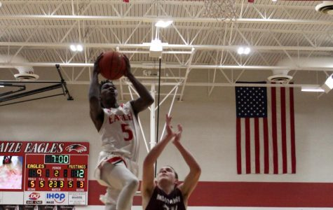 Slide: Boys basketball defeats Salina South