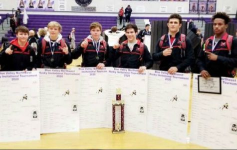 The wrestling team with their first place bracket.