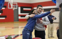 Senior Emily Laham and Freshman Dominic Espinoza celebrate before Laham's signing on Wednesday.
