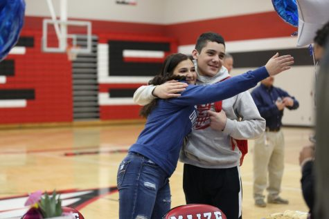 Senior Emily Laham and Freshman Dominic Espinoza celebrate before Laham